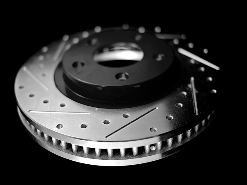 adam's rotors classic cross drilled and slotted machined through drill hole performance rotor with drilling and slots